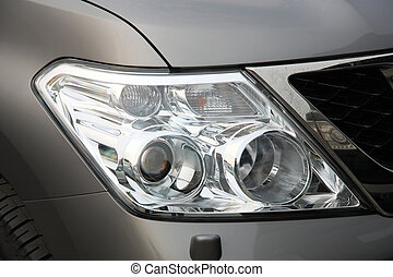 Closeup of car headlight - front view