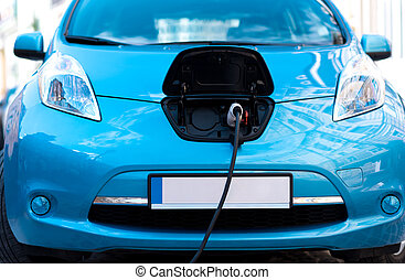 Closeup of car plugged to charge battery