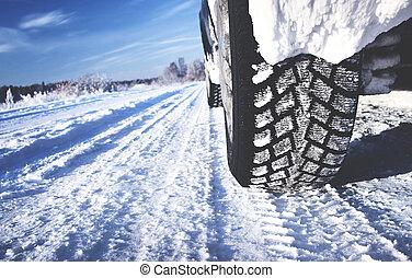 Closeup of car tires in winter