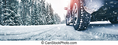 Closeup of car tires in winter on the road