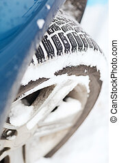 closeup of car winter tire - transportation, winter and...