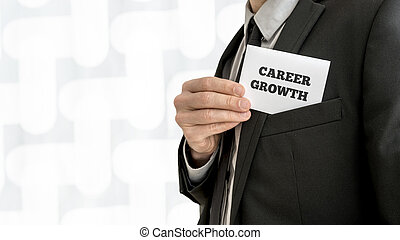 Closeup of career adviser taking his business card out of a jacket pocket