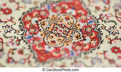 Closeup of carpet, pattern rotates - closeup of ornament on...