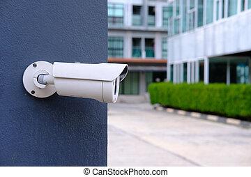Closeup of CCTV camera on a wall.
