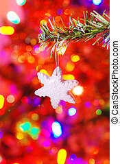ceramic snowflake on a branch