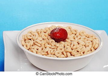closeup of cereal with a strawberry