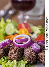 closeup of cevapcici on a plate