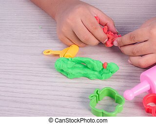 child play modeling clay - closeup of child play modeling...