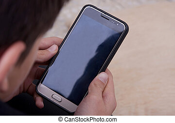 closeup of child with mobile phone