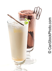 Closeup of chocolate and vanilla smoothies on white background