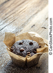 Closeup of chocolate muffin with sugar