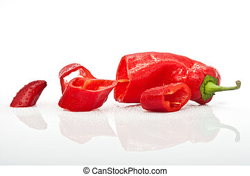 chopped red hot pepper with water drops isolated on white background