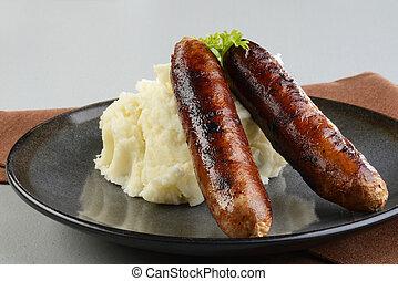 closeup of chorizo sausages with mashed potato