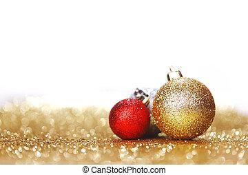 Christmas balls - Closeup of Christmas balls on shiny golden...