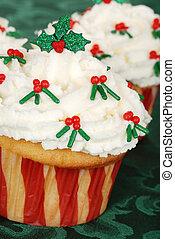 closeup of christmas holly cupcake