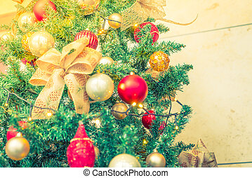 Closeup of Christmas tree decorations background ( Filtered...