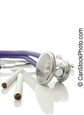 Closeup of cigarettes and stethoscope
