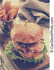 Closeup of classical homemade burgers. Set with beverage and potato