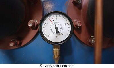 Closeup of clean pressure gauge against blurry background