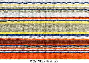 Closeup of colored knitted wool texture. Fabric multicolor background