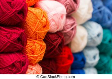closeup of colorful wool yarn balls in knitting store