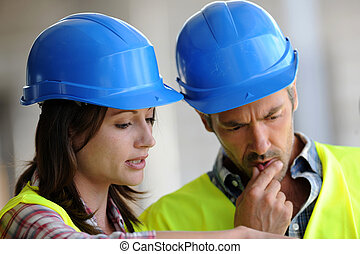 Closeup of construction people with blue security helmet