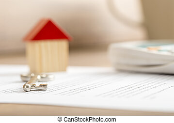 Closeup of contract of house sale ready to be signed with...