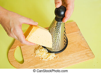 Closeup of cook grating cheese
