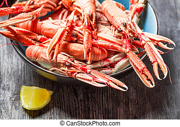 Closeup of cooked scampi with lemon