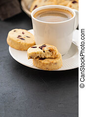 Closeup of cookies and a cup of coffee. Symbolic image. Concept for a tasty snack. Sweet dessert. Selective focus. Close up.