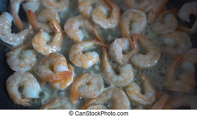 Closeup of cooking shrimp in pan - Closeup video of cooking...