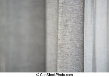 closeup of cotton curtain with shallow depth of field