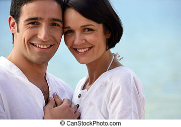 Closeup of couple at the beach