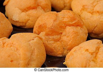 Closeup of cream puffs - Closeup shot of freshly baked cream...