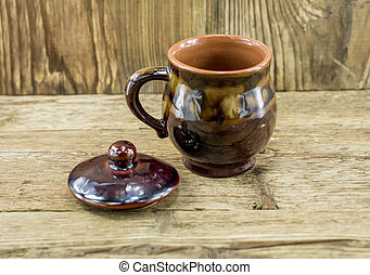 closeup of cup with tea in asian style on wooden desk and wooden background