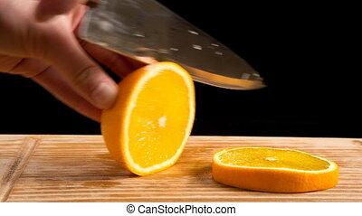 Closeup of cut orange slice on cutting board