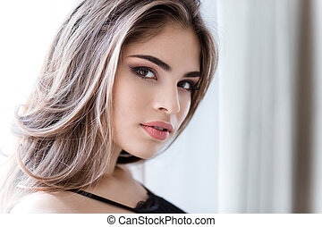 Closeup of cute lovely woman with natural makeup