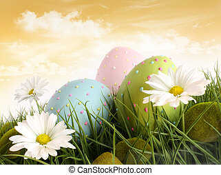 Closeup of decorated easter eggs in the grass with flowers
