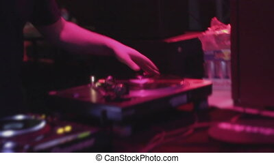 """""""Closeup of deejay hand scratching vinyl record on sound deck"""""""