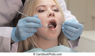 Closeup of dentist examines patient