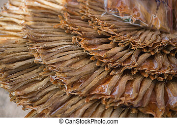 Closeup of dried fish preservation in food market