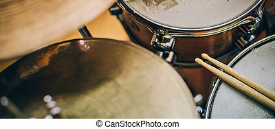 Closeup of drumsticks lying on the drum set. Drummer...