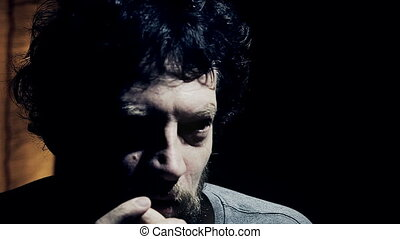 Closeup of drunk man smiling looking camera