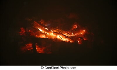 Closeup of dying embers in fireplace