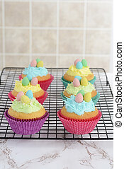 easter cupcakes cooling on wire rack