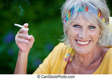 elderly woman smoking cigarette