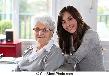 Closeup of elderly woman with young woman