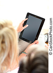 Closeup of electronic tablet hold by woman