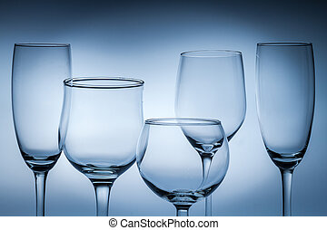 Closeup of empty glasses on a blue background