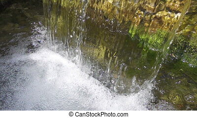 closeup of falling water in fountain, slow motion 250 fps